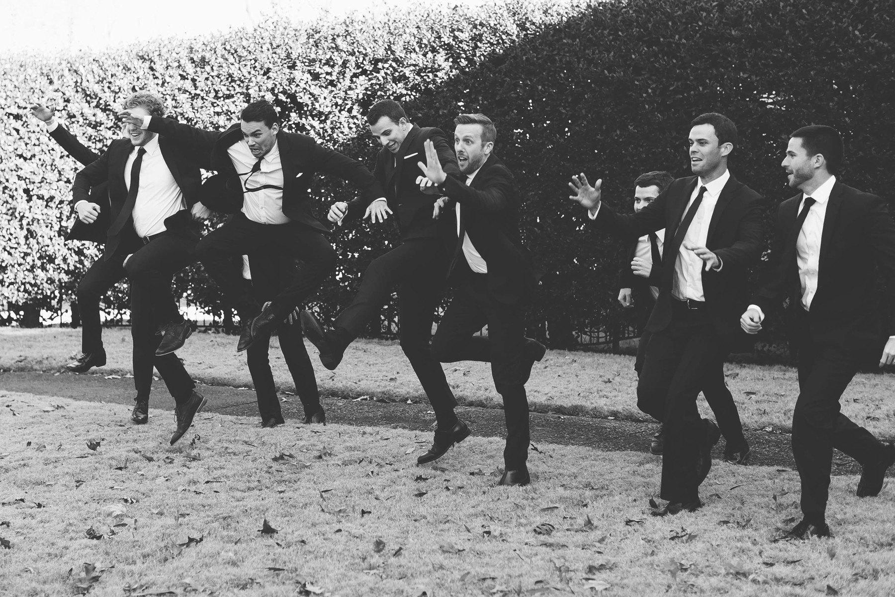 The handsome groomsmen goof off.