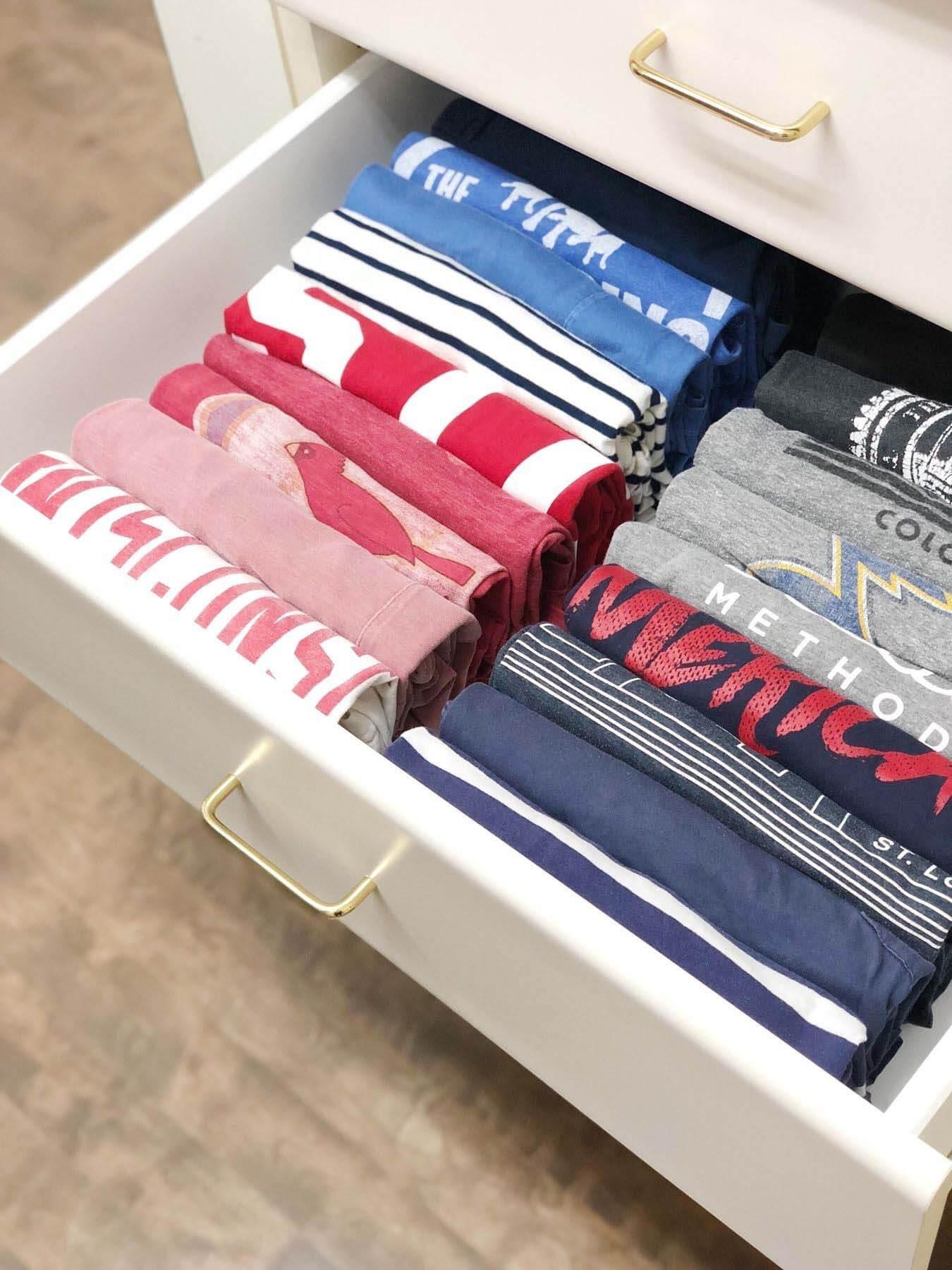 Folded t-shirts in dresser drawer